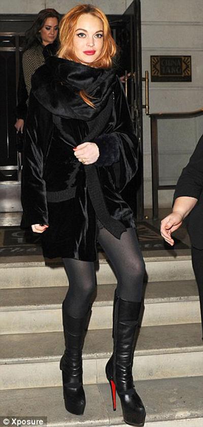 Lindsay Lohan no es una dama de compañía de clase alta!