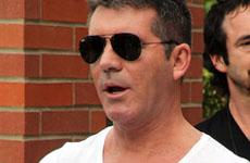 Simon Cowell mencionado en el divorcio de su amigo