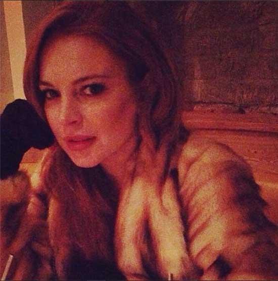 Lindsay Lohan perdió su abrigo de piel - KARMA!!!