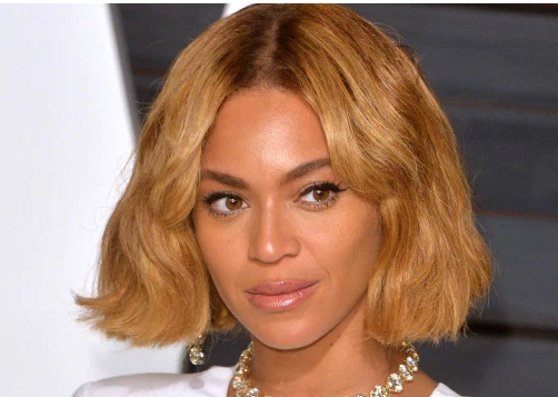 Beyonce's natural hair shown by her mother