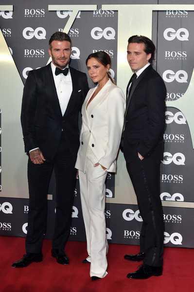 Brooklyn con sus padres David y Victoria Beckham