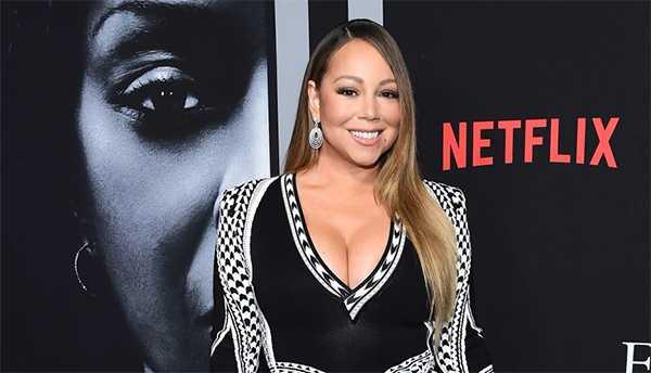 Hermana de Mariah Carey la demandó por su libro